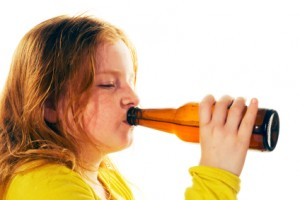 child drinks beer