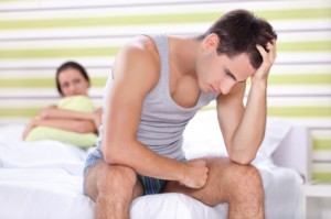 Unhappy couple in bedroom